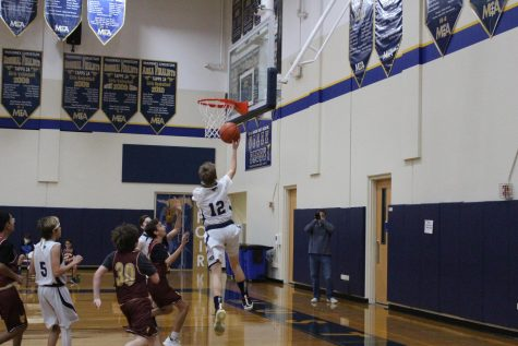Seventh grader Huston Clayton makes the layup to push the Mustangs lead.