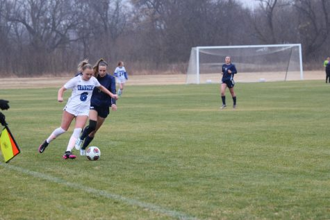 Senior Ruth Perry defends a Dallas Christian player in a rainy game.