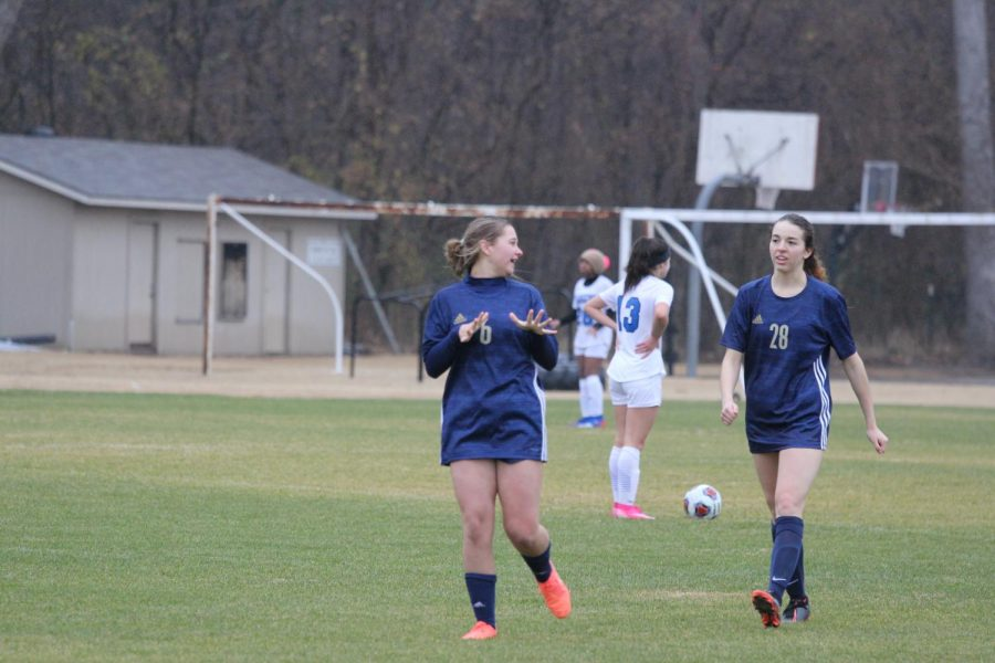 Senior Emma DeMaagd and sophomore Abigail Thomas celebrate after their 10th goal.