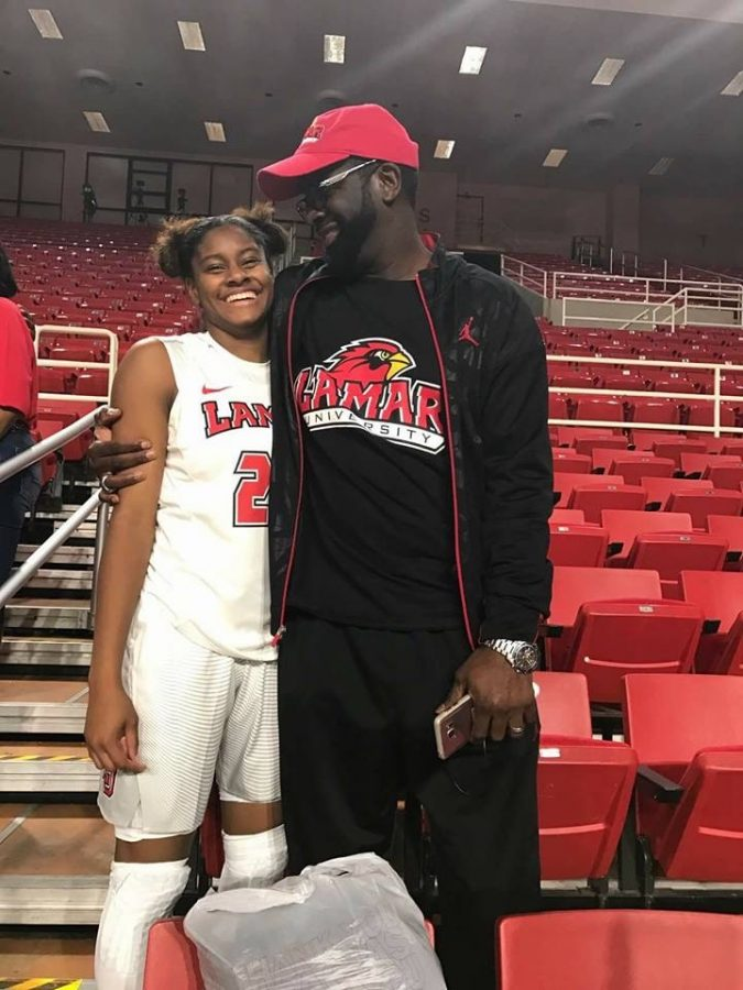 Coach Miles posing for a picture with her father after her game at Lamar university.