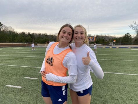 Seniors Annie Weichel and Hallie Witte pose for a picture before the game.