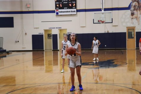 Eighth grader Casey Geradis gets ready to shoot a free throw.