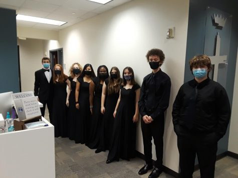 The choir members line up for a picture after their performance.