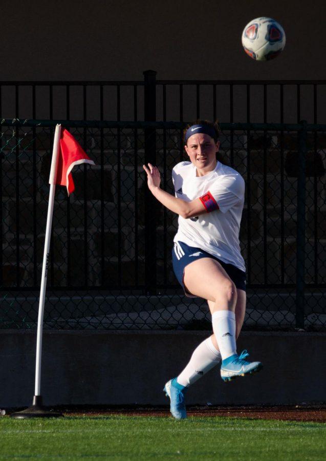 Senior Annie Weichel sends the ball toward the net on a corner kick.