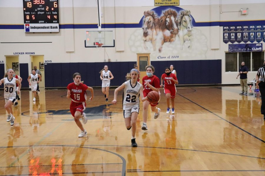 Eighth grader Kadence Ackmann dribbles down the court after a steal.