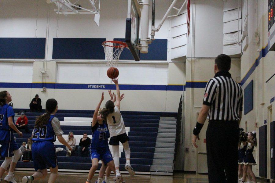 Seventh grader Sadie Zbranek drives towards the basket to make a layup.