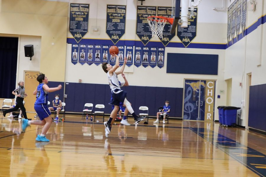 Eighth grader Noah Melton finishes a fastbreak layup.