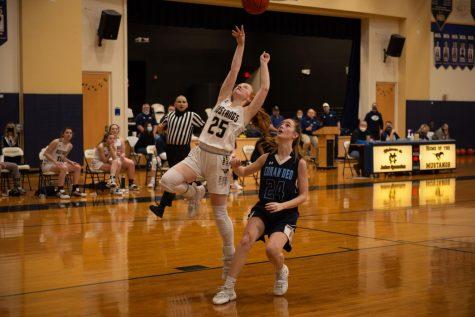 Freshman Grace Krause  shoots a layup.