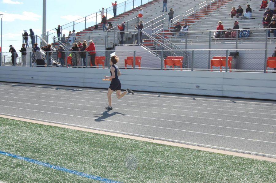 Freshman David Roller competes in 4x400 meter.