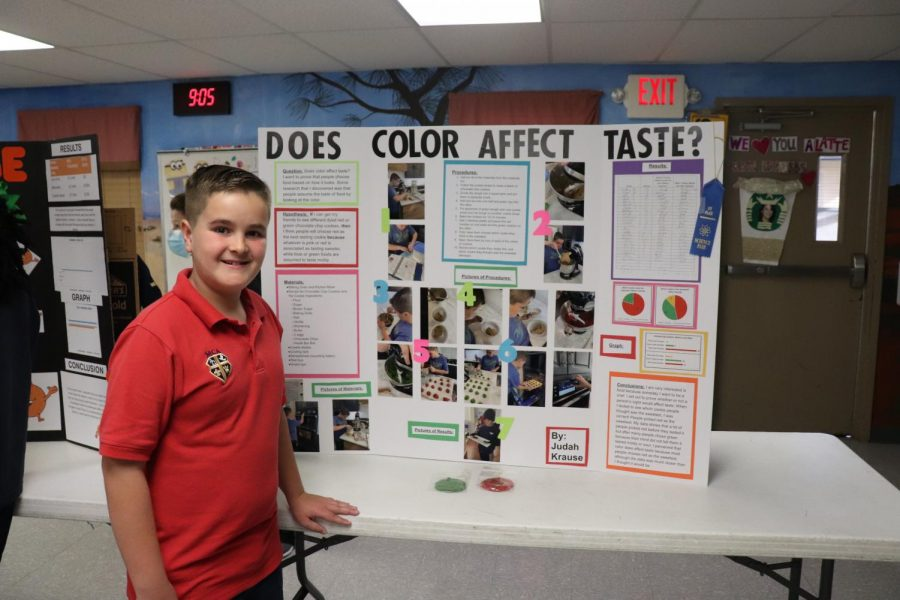 Fifth grader Judah Krause poses with his first place project.