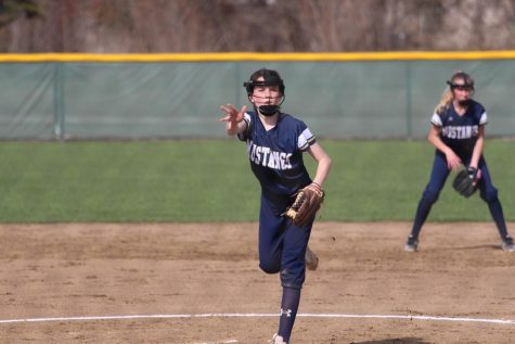 Seventh grader, Sadie Zbranek pitches the ball to the opposing team.