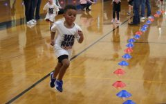 Pre-K student Jadon Lewis runs around the cones for the Fun Run on Thursday