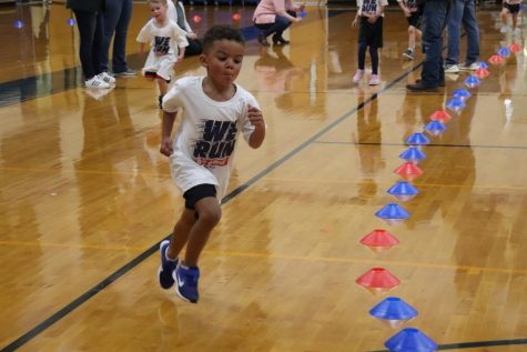 Pre-K student Jadon Lewis runs around the cones for the Fun Run on Thursday