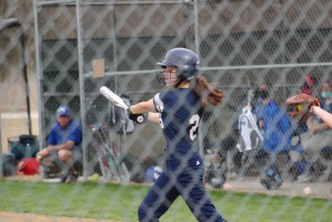 8th grader Ryan Tessier swings the bat looking to get a hit.