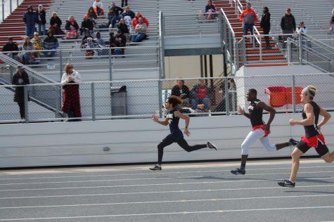 Senior Maliq Brock breaks 200 meter dash school record.