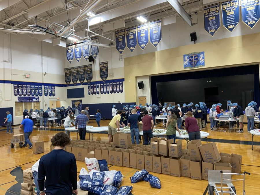 The Upper School students work hard to pack meals for Kids Against Hunger.