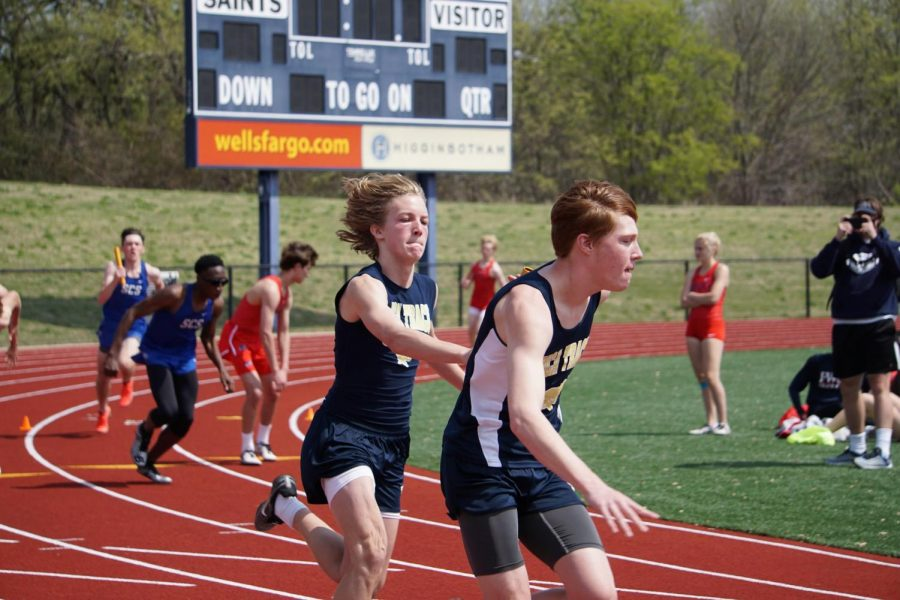 Pederson and Dover-Smith hand off the baton in the 4x400 relay.