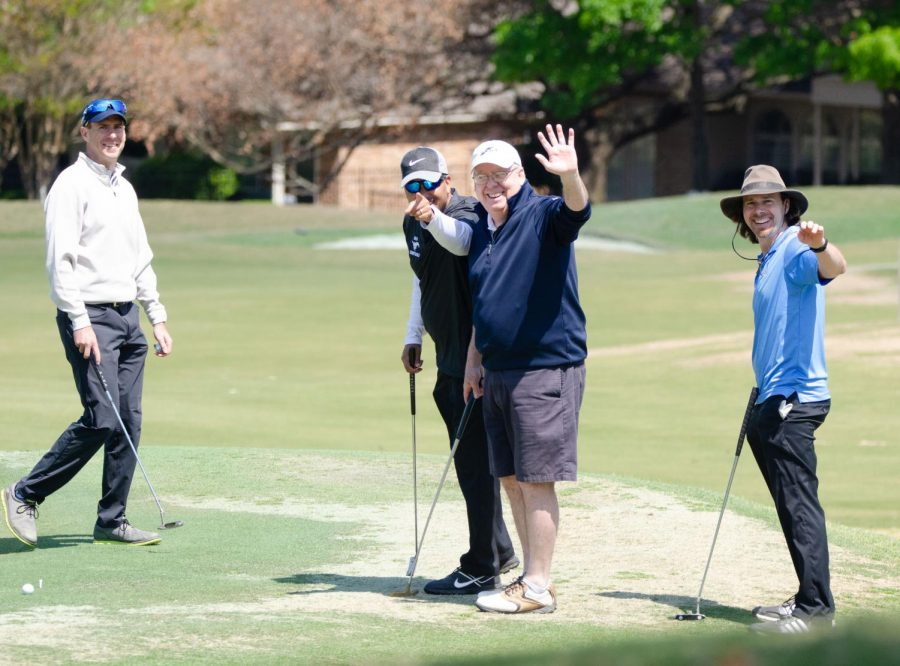 Golfers+waving+at+the+golf+tournament.+