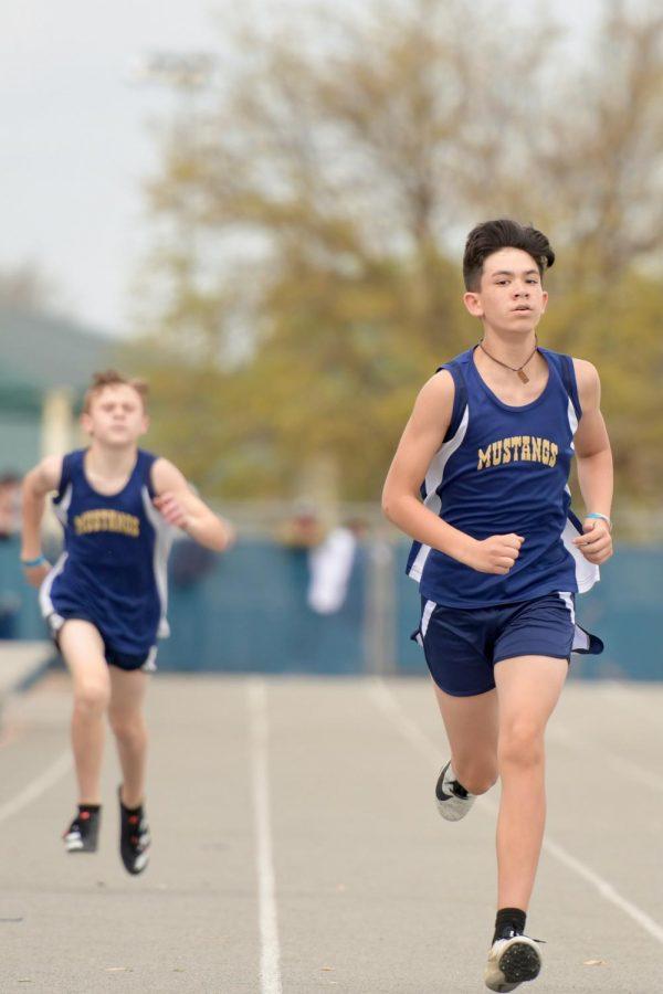 Sixth grader, Joey Gunn looks ahead as he continues his race.