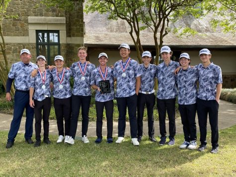 Boys Golf poses for a picture with their medals after winning the District Championship.