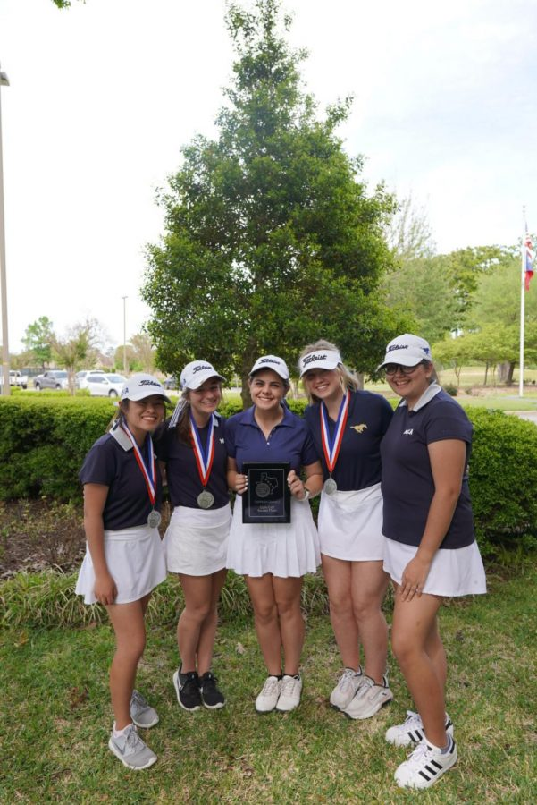 Girls Golf poses for a picture with their medals after finishing runner-up.