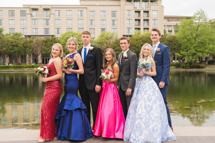 MCA seniors and sophomore Lily Jornod posing with their dates.