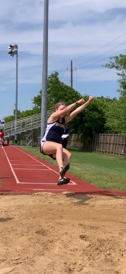 7th Grader Natalie Siebrasse participates in the long jump.