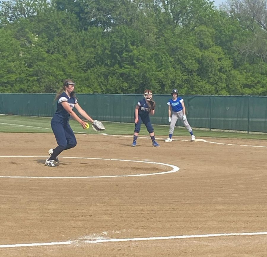 Eighth grader Ella Van Voorst in motion as she pitches the ball.