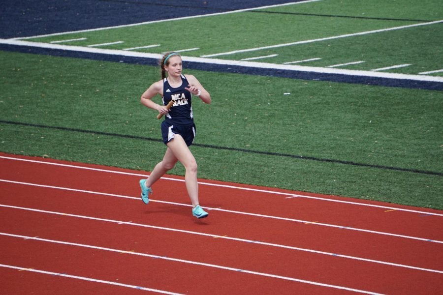 Sophomore Leigh Evan Kitzmiller finshies the 4x400 race.