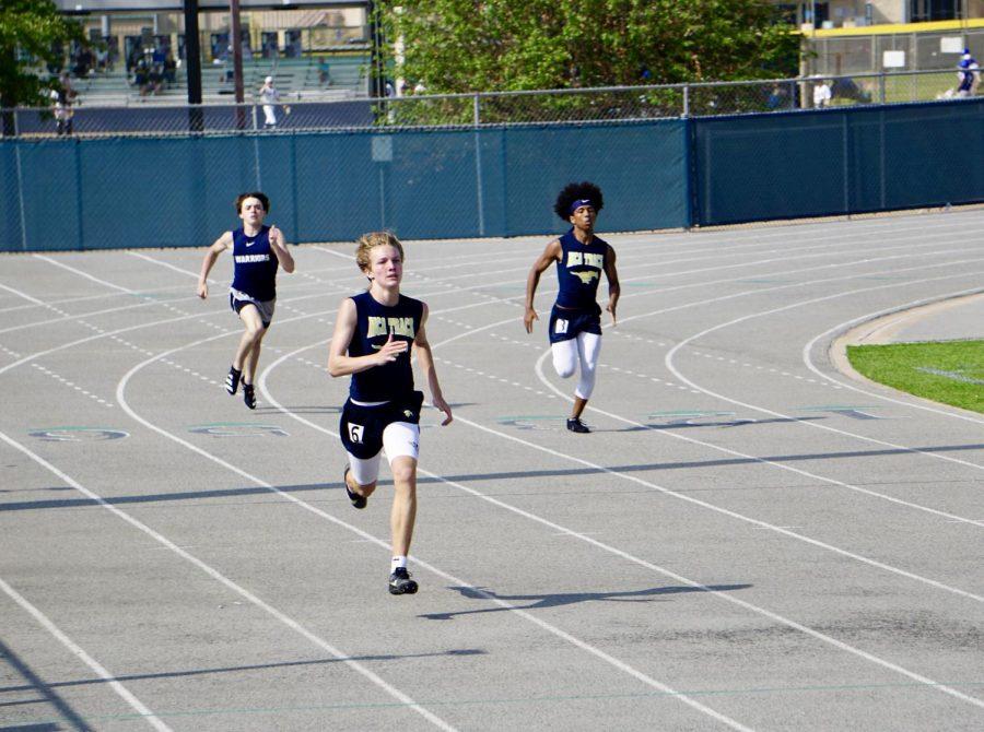 Junior Maddox Pederson sprints in the 200 meter dash.