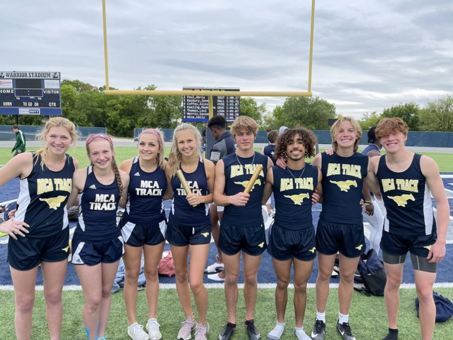 The MCA boys and girls relay teams pose for a picture after qualifying for the state meet.
