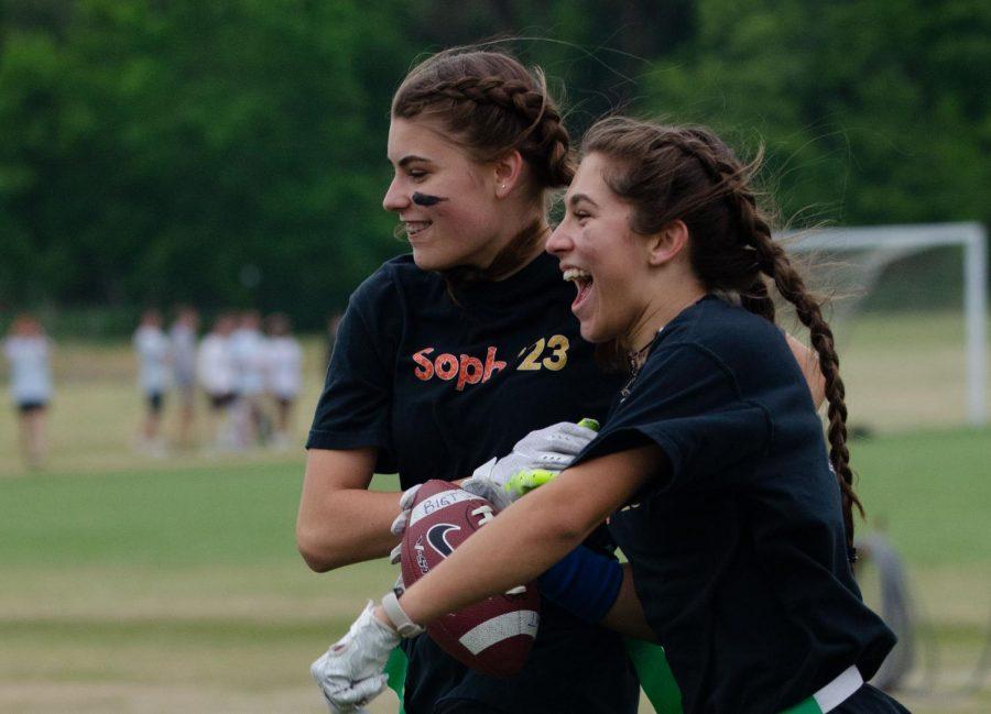 Sophomores Belle Kanz and Alexa Harriman celebrate a touchdown.