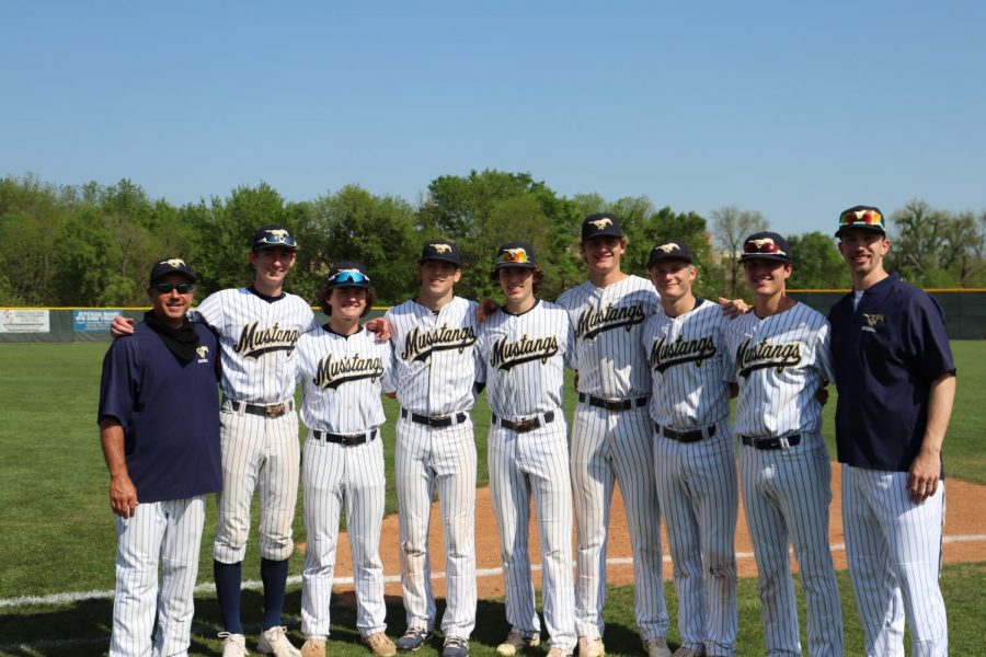 Baseball seniors pose with head coach Mike Pirtle.