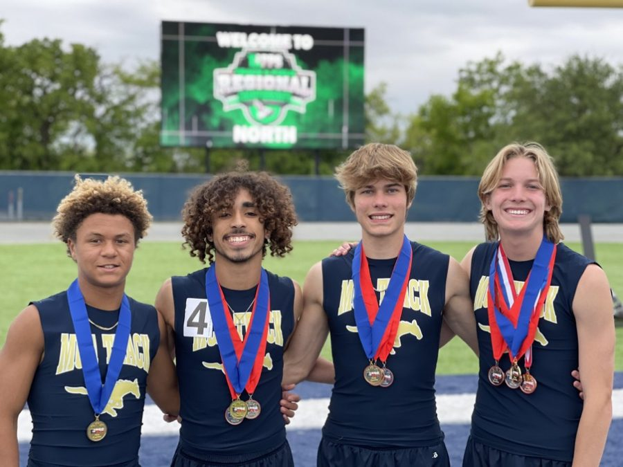 MCA relay team poses with their medal after placing first in the 4x400.