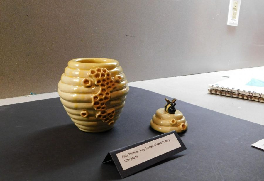Sophomore Abby Thomas's clay honey pot is put on display.