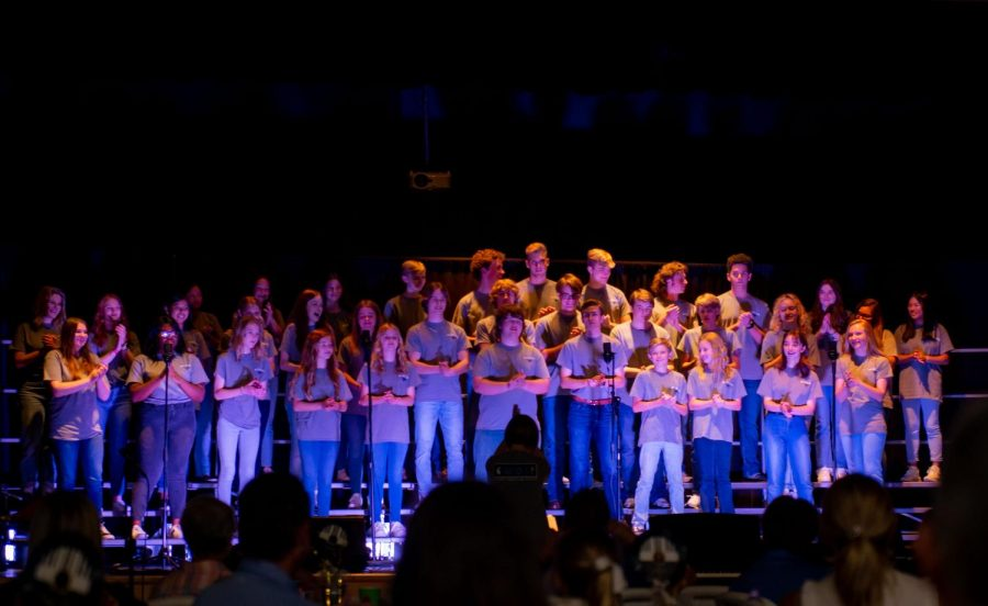Upper School ensemble and choir and Middle School choir sing together.