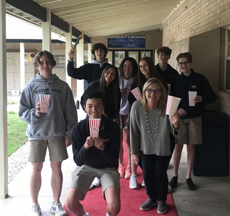 Students pose for a picture on the red carpet.