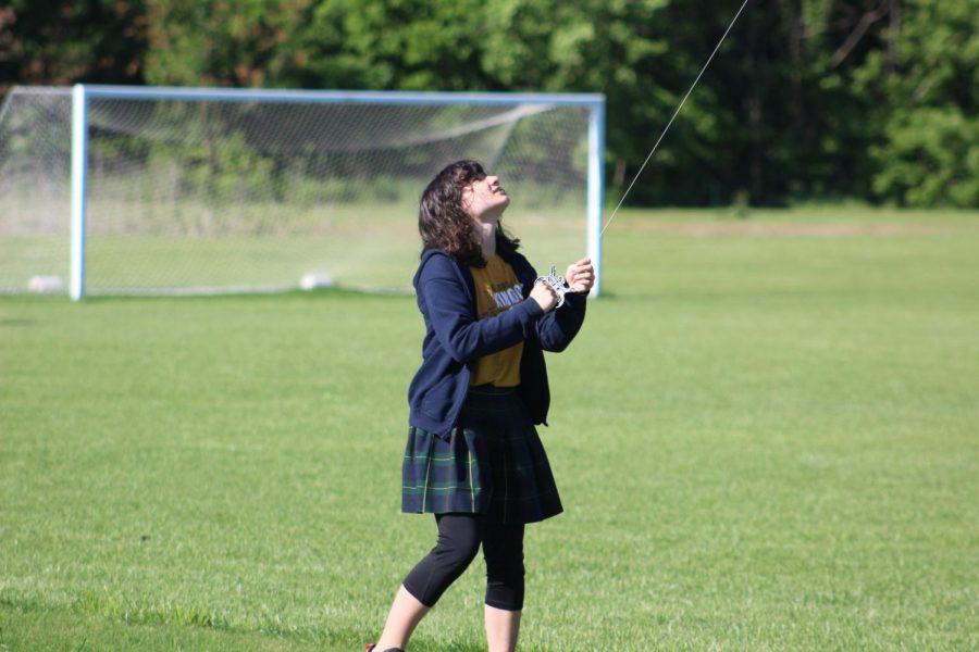 Fifth grader Bella Tucker keeps her kite steady.
