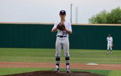 Eighth grader Marc Jensen takes the mound.