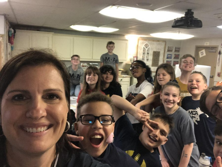Mrs. Krusing poses for a picture with her last fifth grade class.