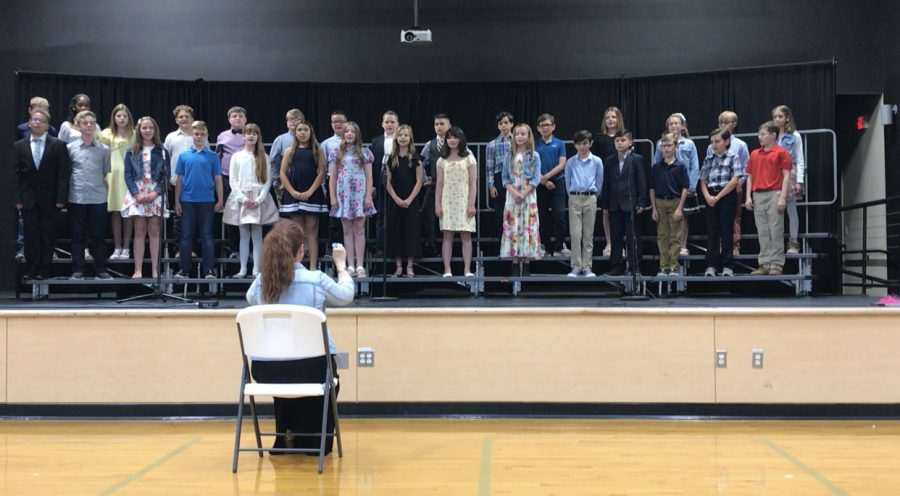 Fifth graders singing their song during graduation.