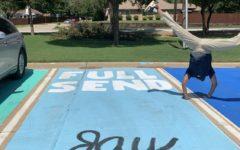Senior Jay Johnson does a cartwheel over his parking spot.