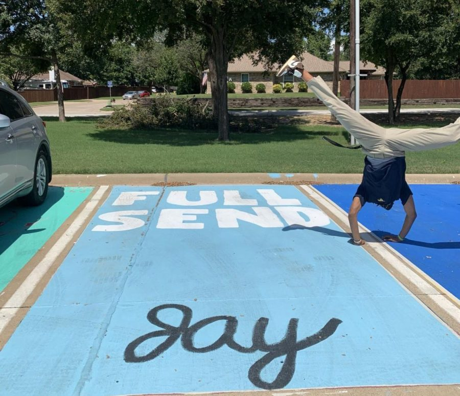 Senior+Jay+Johnson+does+a+cartwheel+over+his+parking+spot.