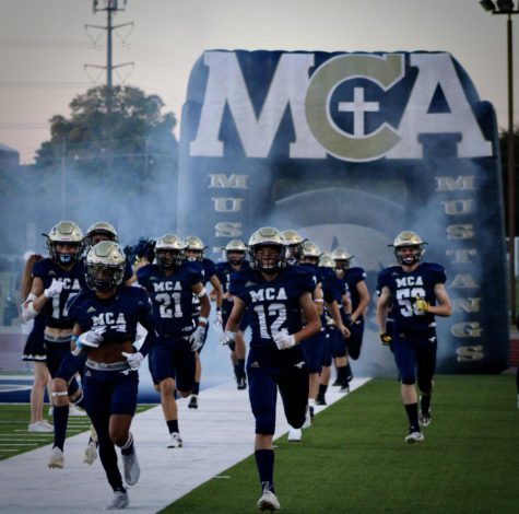 The McKinney Mustangs ran out of the tunnel, ready to take on Westlake.