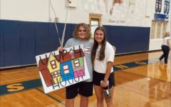 Junior Matthew McDowell asked Junior Sarah Krusing after a home volleyball game.